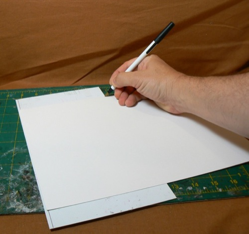 Photograph of using corrugated styrene sheet  to measure Bristol board