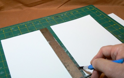 Photograph of cutting Bristol Board for the  HO scale metal roofing