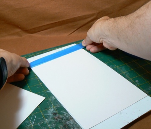 Photograph of taping Bristol Board to the HO  scale corrugate metal styrene sheet