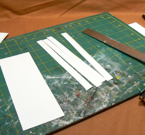 Photograph of cutting out strips of HO scale  corrugated roofing